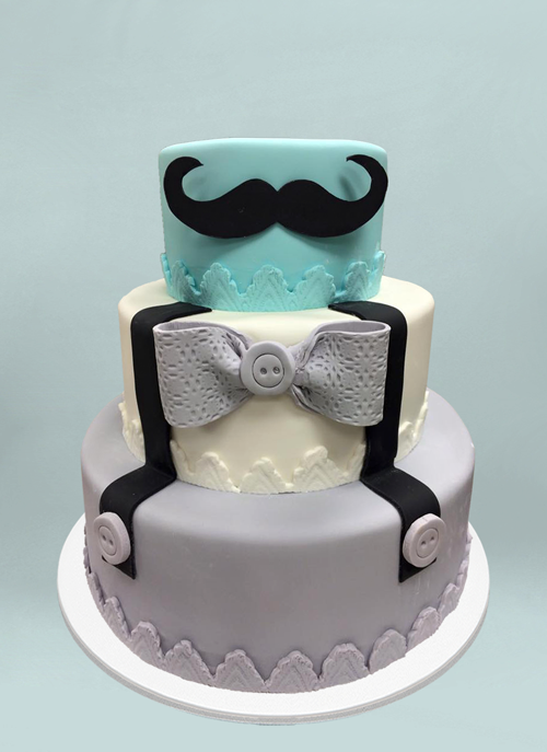 Photo: fondant cake with giant mustache and suspenders