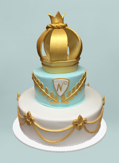 Photo: clean fondant 2 tier cake with gold leaves and crown on top tier