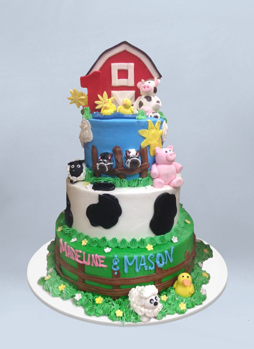 Photo: frosted 4 tier cake with farm animals and barn