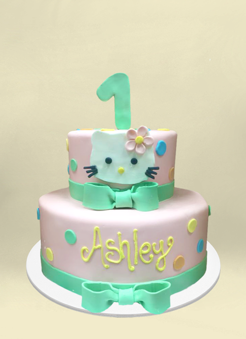Photo: fondant cake with hello kitty face and polka dots