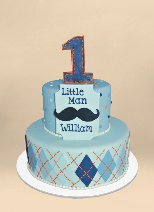 Photo: light blue fondant cake with orange and blue argyle patter, large #1 on top