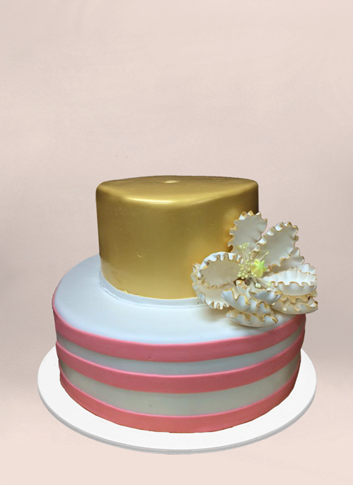 Photo: fondant cake, pink and white stripe, solid gold tier with large sugar flower