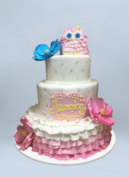 Photo: 3 tier fondant cake with sugar flowers and pink owl on top