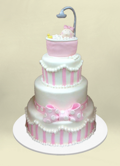 Photo: 4 tier pink and white fondant cake with bubbly tub, shower on top