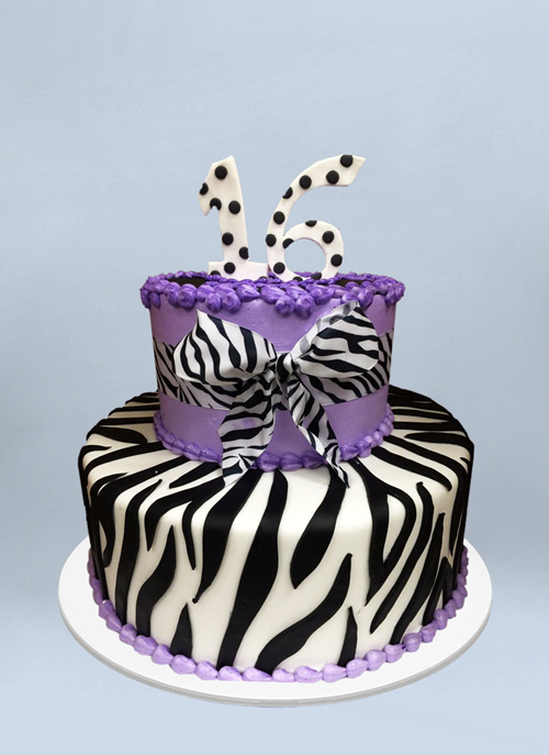 Photo: 2 tier zebra fondant cake with purple frosting