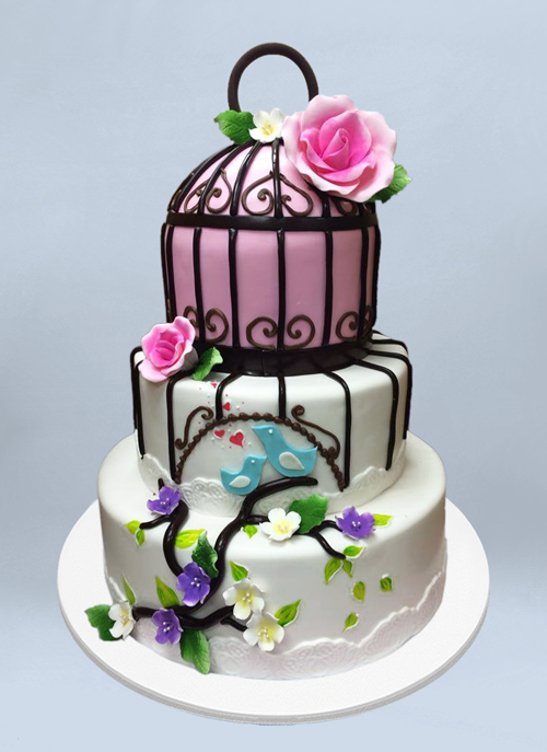 Photo: fondant cake with forsted bird cage pattern and sugar flowers