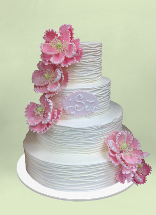 Photo: 4 tier white forsted pattern cake with pink sugar flowers