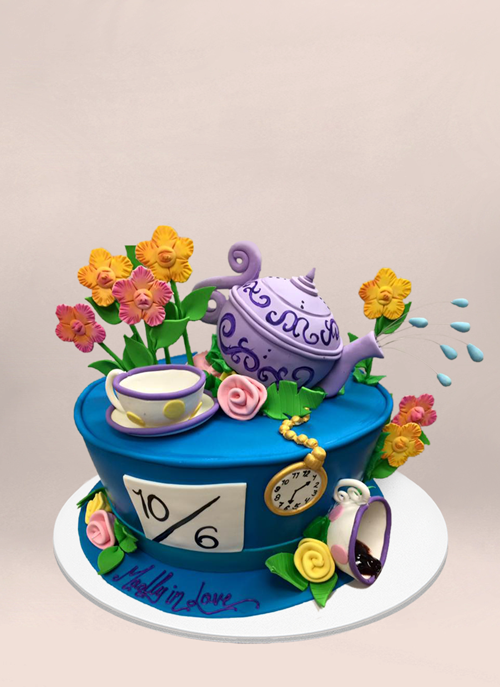 Photo: mad hatter themed hat with 3d fondant teapot, cup, flowers and clock