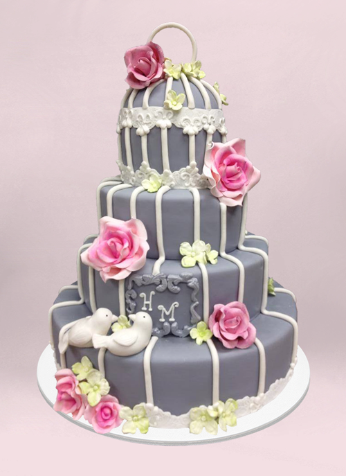 Photo: 4 tier fondant cake with flowers and piping to look like a bird cage