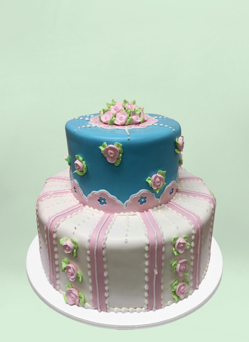 Photo: 2 tier fondant cake with small frosted flowers and patterns