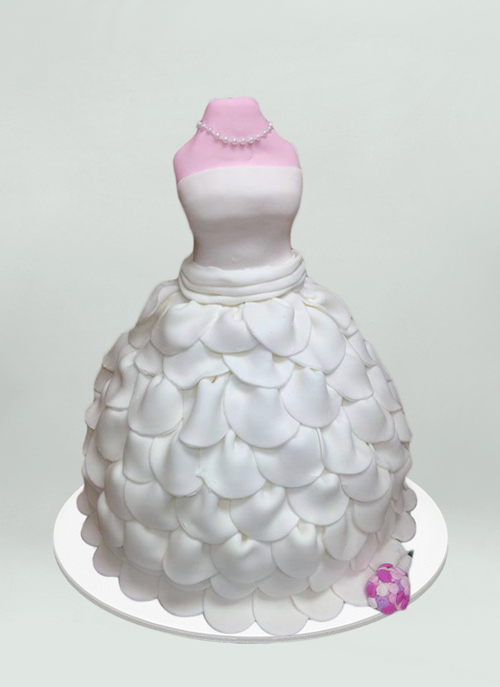 Photo: cake shaped like mannequin wearing a white layered wedding dress