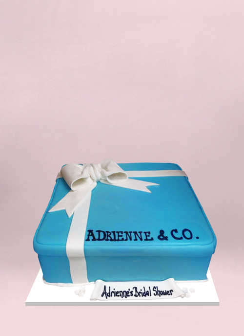 Photo: blue tiffany box shaped cake with white fondant ribbon