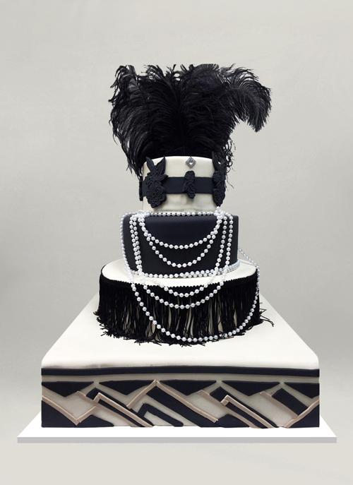 Photo: black and white fondant cake with flapper elements on each tier, fringes, pearls, feathers