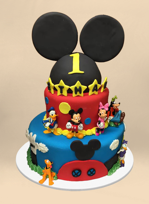 Photo: fondant cake with Mickey Mouse ears and dimensional Mickey characters around the tiers