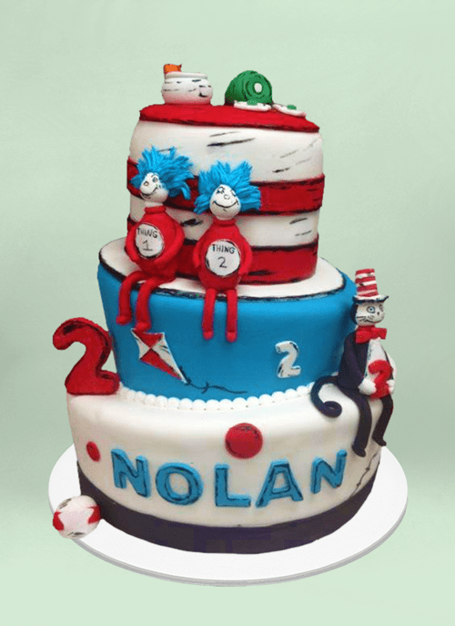 Photo: fondant cake with dr. suess characters sitting around the tiers