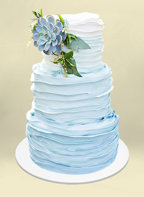 Photo: frosted 3 tiers ombre color white to sky blue and blue succulent and leaves on top tier