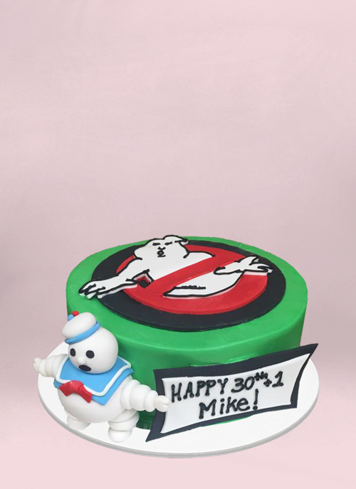 Photo: 1 tier green ghost busters cake with logo on top and 3d fondant ghost