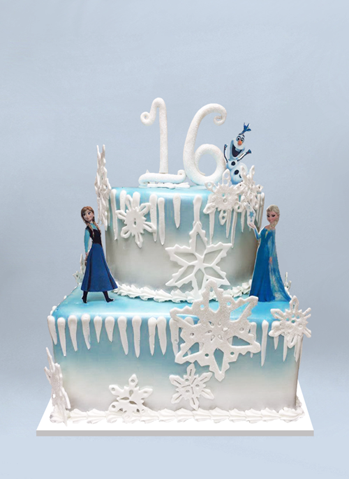 Photo: square blue to white tiers with large fondant snowflakes, icicles and standing characters from Frozen