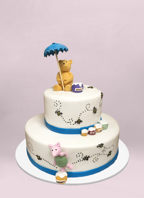 Photo: 2 tier winne the poph cake with bees and honey pattern